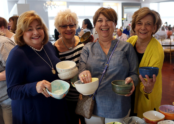 HADLEY GREEN/Staff photo<br /> From left, Gina Razel of Gloucester, Linda Oliveira of Medford, Denise Fazio of Medford, and Anne Marie Leeman of Stoneham attend Open Door Food Pantry's annual Empty Bowl fundraising dinner.