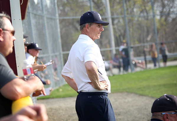 HADLEY GREEN/Staff photo<br /> Danvers head coach Roger Day watches his team play at the Gloucester v. Danvers baseball game at the Nate Ross Field in Gloucester.