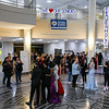 Kids line up for a prom photo in the foyer of the high school