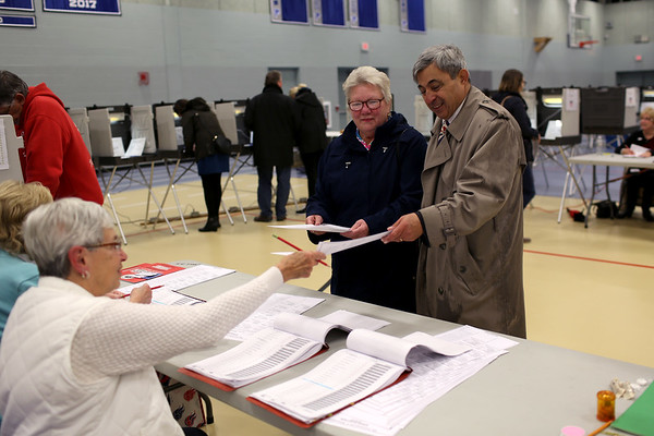 HADLEY GREEN/ Staff photo<br /> Rep. Ted Speliotis and his wife June vote at Danvers High School on Election Day.<br /> <br /> 11/06/2018