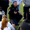 HADLEY GREEN/ Staff photo<br /> Danvers head coach Jimmy Hinchion speaks to his players during halftime at the Danvers v. Winchester Division 2 North championship game at the Manning Field in Lynn.<br /> <br /> 11/12/2018