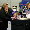 HADLEY GREEN/ Staff photo<br /> Meaghan Toomey submits her ballot with help from her daughter, Abigail, at Danvers High School on Election Day.<br /> <br /> 11/06/2018