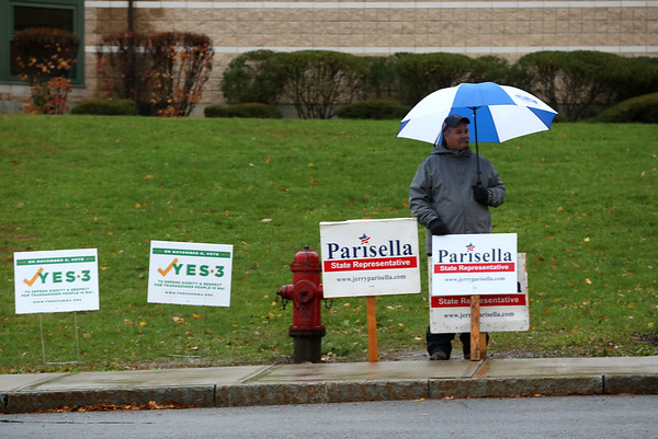HADLEY GREEN/ Staff photo<br /> Eric Fowler of Beverly stands with Rep. Jerry Parisella signs outside the North Beverly Elementary School polling location on Election Day.<br /> <br /> 11/06/2018