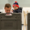HADLEY GREEN/ Staff photo<br /> Two-year-old Aidan Colgan looks over his dad Anthony's ballot at the Danvers High School polling location on Election Day.<br /> <br /> 11/06/2018