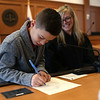 HADLEY GREEN/ Staff photo<br /> Jack Mazzotti of Haverhill signs his name on the decree of adoption next to Judge Jennifer M.R. Ulwick at National Adoption Day at the Probate and Family Court in Salem. Jack was adopted by Valerie and Christopher Mazzotti of Haverhill. <br /> <br /> <br /> <br /> 11/16/2018