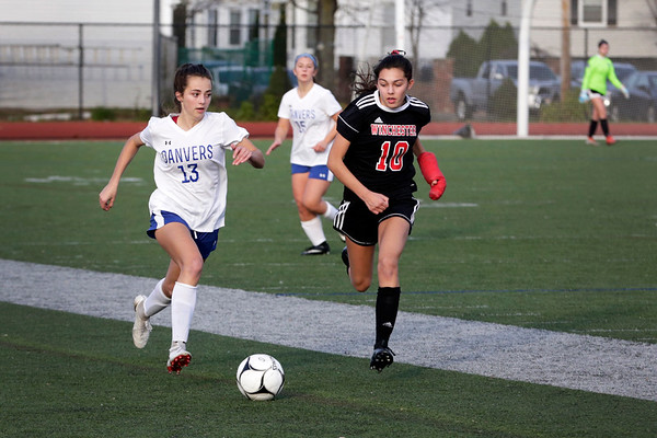 HADLEY GREEN/ Staff photo<br /> Danvers' Riley DiGilio (13) dribbles the ball next to Winchester's Ella Stone (10) at the Danvers v. Winchester Division 2 North championship game at the Manning Field in Lynn.<br /> <br /> 11/12/2018
