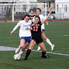 HADLEY GREEN/ Staff photo<br /> Danvers' Riley Baker (19) and Winchester's Augusta Burhans (17) vie for the ball at the Danvers v. Winchester Division 2 North championship game at the Manning Field in Lynn.<br /> <br /> 11/12/2018