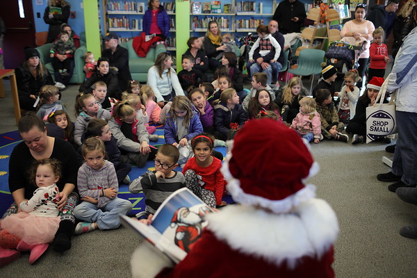 Mrs. Claus reads a Christmas story at the library during the annual Holiday Stroll in Peabody, Saturday, November 24, 2018. Jared Charney / Photo