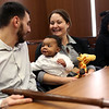 HADLEY GREEN/ Staff photo<br /> Amanda and Robert Mogauro of Peabody hold their newly adopted son, Tyler, at National Adoption Day at the Probate and Family Court in Salem. <br /> <br /> <br /> <br /> 11/16/2018