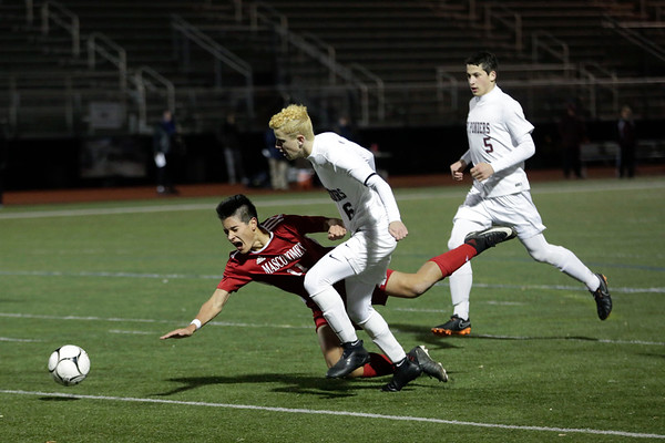 HADLEY GREEN/ Staff photo<br /> Masconomet's Aeden Salvador (11) heads the ball towards the goal at the Masconomet v. Arlington Division 2 North championship game at the Manning Field in Lynn.<br /> <br /> 11/12/2018