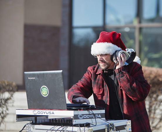 DJ Kevin Angelli stings music at City Plaza during the annual Holiday Stroll in Peabody, Saturday, November 24, 2018. Jared Charney / Photo