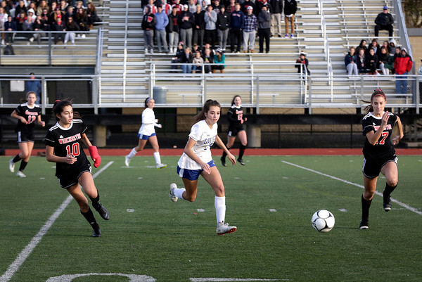 HADLEY GREEN/ Staff photo<br /> Danvers' Riley DiGilio (13) chases the ball during the Falcons' Division 2 North championship contest against Winchester at the Manning Field in Lynn.<br /> <br /> 11/12/2018