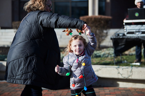 Angela O'Brien spins her daughter Brooke at City Hall during the annual Holiday Stroll in Peabody, Saturday, November 24, 2018. Jared Charney / Photo