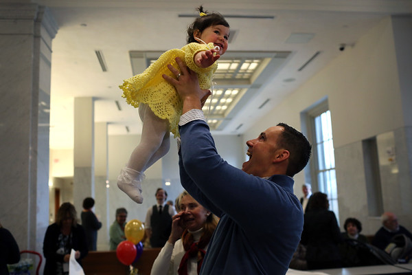 HADLEY GREEN/ Staff photo<br /> Matt Samalis of Swampscott holds his newly adopted one-year-old daughter, RoseMarie, at National Adoption Day at the Probate and Family Court in Salem. Seven families from throughout the Merrimack Valley and North Shore finalized and celebrated their adoptions at the courthouse. <br /> <br /> 11/16/2018