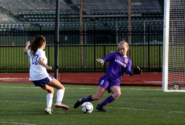 HADLEY GREEN/ Staff photo<br /> Danvers' Riley DiGilio (13) dribbles towards the goal at the Danvers v. Winchester Division 2 North championship game at the Manning Field in Lynn.<br /> <br /> 11/12/2018