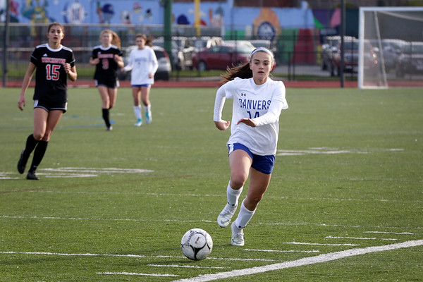 HADLEY GREEN/ Staff photo<br /> Danvers' Abigail Cash (14) dribbles the ball during the first half of her team's contest against Winchester in the Division 2 North championship game at the Manning Field in Lynn.<br /> <br /> 11/12/2018