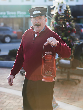 Tom Gould calls out for people to join in him on a trolley during the annual Holiday Stroll in Peabody, Saturday, November 24, 2018. Jared Charney / Photo