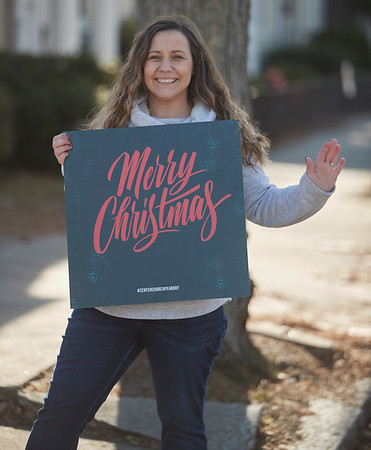 Jennifer Gagnon of Center Curch holds a telling sign during the annual Holiday Stroll in Peabody, Saturday, November 24, 2018. Jared Charney / Photo