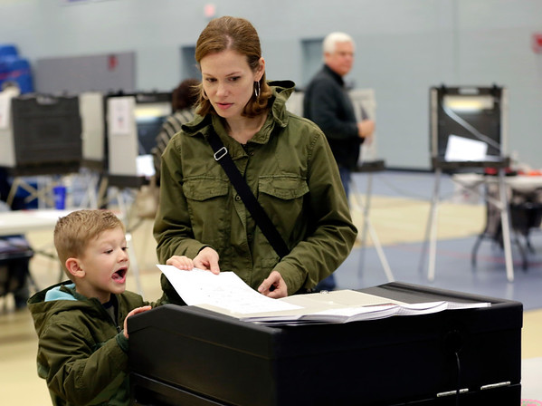 HADLEY GREEN/ Staff photo<br /> Elisabeth Reickert votes with her son, Dexter, 4, at the Danvers High School polling location on Election Day.<br /> <br /> 11/06/2018