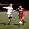 HADLEY GREEN/ Staff photo<br /> Masconomet's Aeden Salvador (11) dribbles the ball during his team's match against Arlington for the Division 2 North championship title at the Manning Field in Lynn.<br /> <br /> 11/12/2018