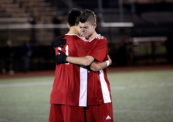 HADLEY GREEN/ Staff photo<br /> Masconomet's Josh Rubin (44) and Aeden Salvador (11) hug after losing against Arlington in the Division 2 North championship game at the Manning Field in Lynn.<br /> <br /> 11/12/2018