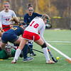 AMANDA SABGA/Staff photo <br /> <br /> Masconomet's Lily Conway (18) tries to get a shot in the goal during the division one north field hockey championship game at North Andover High School. Masconomet defeated Andover 2-1 in sudden death overtime.<br /> <br /> 11/10/18