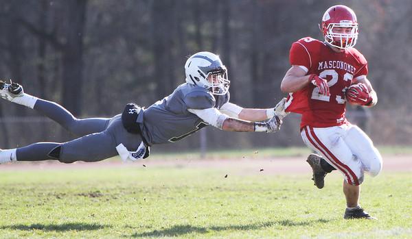 Masconomet's Captain Scott Foden eludes Pingree's Jackson Latimer as he carries the ball for a touchdown Thursday, Nov. 26, at Masconomet high School.