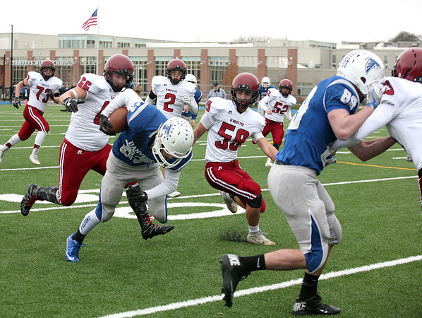 Quintin Holland, #33, runs the ball trying to get away from Jacob Russell, #66, and Kyle Aquipel for Gloucester during the Gloucester vs Danvers annual Thanksgiving Day football game. Danvers won 41-26.<br /> Nov. 24, 2016
