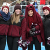 Gloucester cheerleaders Bridie Newhall, Lexi McRobb, Gianna Sanfilippo, and Grace Brancaleone, all seniors, cheer for their team during the Thanksgiving Day football game played at Dr. Deering Stadium in Danvers.