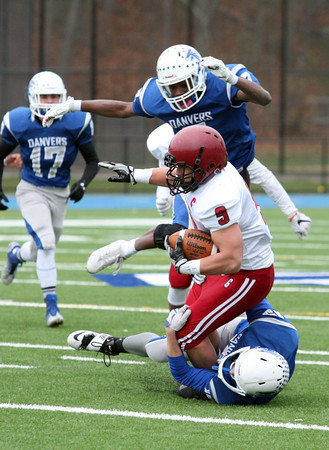 Danvers Zach Turner and Tahg Coakley tackle Christian Sanfilippo during first quarter action of the Thanksgiving Day game. Danvers beat Gloucester 41-26.<br /> Nov. 24, 2016
