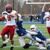 Gloucester's Christian Sanfilippo, #9, gets tackled by Justin Ditomaso, #12, and Franco Abbatessa, #32 for Danvers during the Gloucester vs Danvers annual Thanksgiving Day football game at Dr.  Deering Stadium in Danvers.  Danvers won 41-26.<br /> Nov. 24, 2016