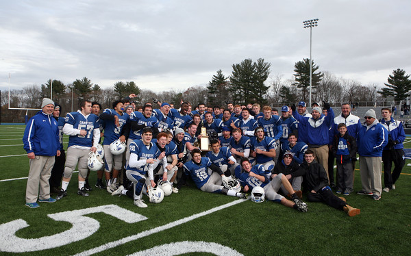 The Danvers football team celebrate their win over Gloucester during the annual Thanksgiving Day football game played at Dr. Deering Stadium. Danvers won 41-26.<br /> Nov. 24, 2016