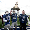 Danvers captains Quintin Holland, from left, Kieran Moriarty and Matt Andreas celebrate their win over Gloucester during  annual Thanksgiving Day football game. Danvers won 41-26 at Dr. Deering Stadium.<br /> Nov. 24, 2016