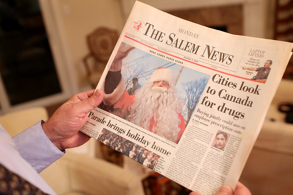 HADLEY GREEN/Staff photo<br /> Charlie Bucci Jr. was the third in his family to be Santa for Beverly's annual Holiday Parade. He holds a December 2003 copy of the Salem News of him dressed up as Santa Claus at the parade. <br /> 11/16/17