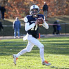 HADLEY GREEN/Staff photo<br /> Hamilton-Wenham's Billy Whelan (10) looks for an open pass at the Hamilton-Wenham v. Stoneham Division 6 North football title game at Hamilton-Wenham High School.<br /> 11/11/17