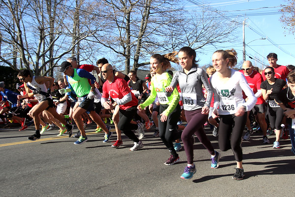 HADLEY GREEN/Staff photo<br /> Runners sprint from the start line of the fourth annual Back the Track 5K in Marblehead. <br /> <br /> 11/25/17