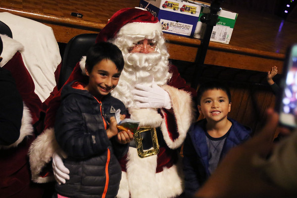HADLEY GREEN/Staff photo<br /> From left, Dominic Cieslik and Kyle Neil of Peabody get a photo with Santa Claus in Peabody's city hall.<br /> 11/25/17