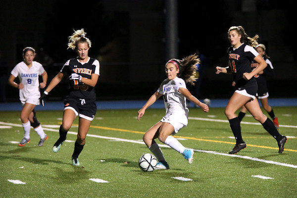 HADLEY GREEN/Staff photo<br /> Danvers' Abby Cash (14) dribbles the ball while Beverly's Leah Whitehair (13) and Alyssa Moreland (11) play defense at the Danvers v. Beverly Division 2 North quarterfinal girls soccer game at Danvers High School.<br /> <br /> 11/04/17