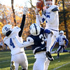 HADLEY GREEN/Staff photo<br /> Stoneham's Jack McCabe (17) intercepts a pass intended for Hamilton-Wenham's Jake Lanciani (3) at the Hamilton-Wenham v. Stoneham Division 6 North football title game at Hamilton-Wenham High School.<br /> 11/11/17