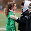 HADLEY GREEN/Staff photo<br /> After the game was tied 2-2 in two overtimes, Danvers' goalie Mackenzie Gilmore gets a pep talk before going in goal for penalty kicks.<br /> <br /> 11/18/17