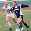HADLEY GREEN/Staff photo<br /> Danvers' Lydia Runnals (1) plays defense against Medway's Abigail Murphy (2) at the Medway v. Danvers Division 2 girls soccer state championship game at Fitchburg State University.<br /> <br /> 11/18/17