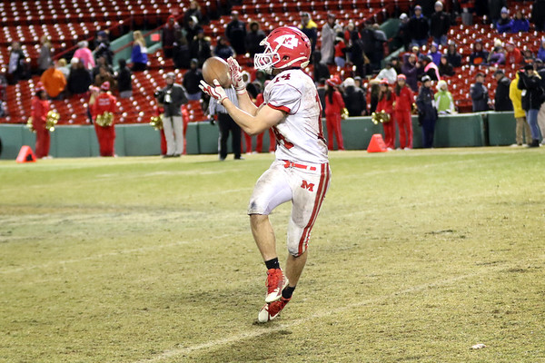 HADLEY GREEN/Staff photo<br /> Masconomet's Jack Seymour (14) catches a pass to make a touchdown at the Masconomet v. Everett football game at Fenway Park.<br /> <br /> 11/22/17
