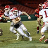HADLEY GREEN/Staff photo<br /> Masconomet's Peter Kitsakos (23) runs through Everett defenders at the Masconomet v. Everett football game at Fenway Park.<br /> <br /> 11/22/17