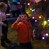 HADLEY GREEN/Staff photo<br /> Jonah Lewis of Portsmouth admires the tree lights at the annual Peabody Holiday Stroll in Peabody center.<br /> <br /> 11/25/17