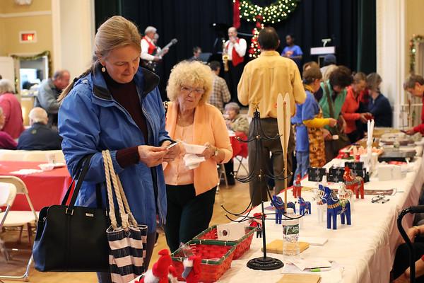 HADLEY GREEN/Staff photo<br /> People shop at the Swedish Yule Fair at the Hamilton-Wenham Community House.<br /> <br /> 11/25/17