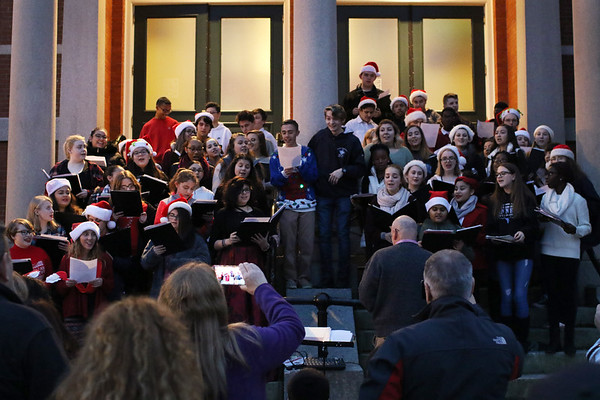 HADLEY GREEN/Staff photo<br /> The Peabody High School Chorale Group sings at the annual Peabody Holiday Stroll in Peabody center.<br /> <br /> 11/25/17