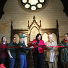 HADLEY GREEN/Staff photo<br /> Christine Lutts, co-chair of Friends of Greenlawn Cemetery and Salem Mayor Kim Driscoll lead the ribbon cutting ceremony for the restored rose window and first phase of the Dickson Memorial Chapel restoration at Greenlawn Cemetery in Salem.<br /> <br /> <br /> 11/25/17