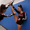 HADLEY GREEN/Staff photo<br /> Gloucester cheerleader Vanessa Rodolosi stretches out her teammate Tara Aquipel before competing at the Massachusetts State Cheerleading Tournament at Worcester State University.<br /> <br /> 11/19/17