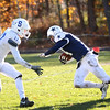 HADLEY GREEN/Staff photo<br /> Hamilton-Wenham's Cam Peach (44) runs through Stoneham defenders at the Hamilton-Wenham v. Stoneham Division 6 North football title game at Hamilton-Wenham High School.<br /> 11/11/17