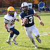 HADLEY GREEN/Staff photo<br /> Hamilton-Wenham's Ian Coffey (13) runs down the field at the Hamilton-Wenham v. Arlington Catholic Division 6 North playoff semifinals football game at Hamilton-Wenham High School.<br /> <br /> 11/04/17